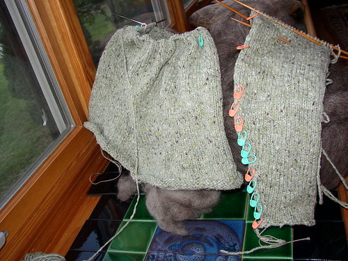 green sweater almost one sleeve