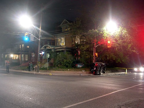 Speeding car crashes into house and SUV rolls over at north east corner of Spadina Road and Bernard Avenue by photopia / HiMY SYeD.