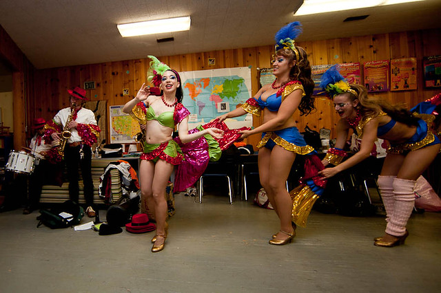 Some members of the Hot Pink Feathers practice their routine backstage at COVA in Oakland