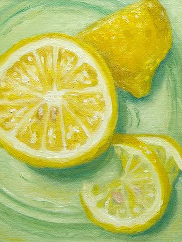 Lemon on green glass plate (P1010468)