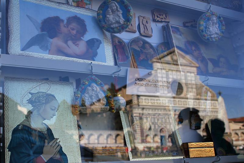 Basilica of Santa Maria Novella reflected in a shop window