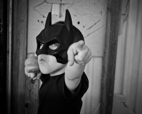 Boy with batman mask strikes a pose