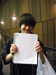 Happy Student with A Paper