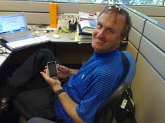 Paul Sherer, PodTech's business development guy with his iPhone
