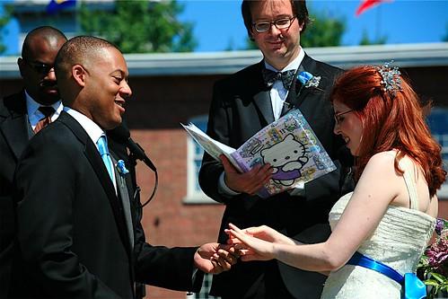 Masheka and Mikhaela exchanging rings...
