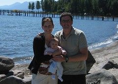 Photo of Claire on the beach in Tahoe with Katherine and Stu