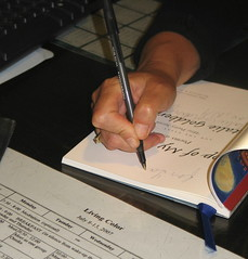 Writer's Hands II, Natalie Goldberg signing copy of Top Of My Lungs, Taos, New Mexico, July 2007, photo © 2007 by QuoinMonkey.All rights reserved.