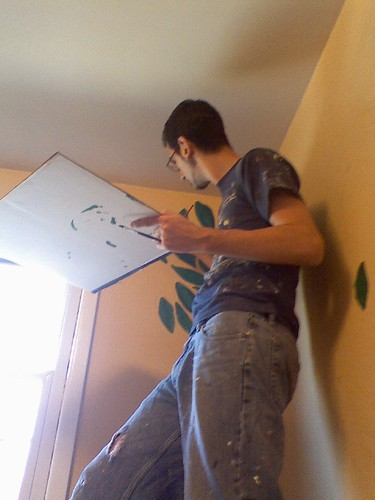 Ben painting leaves