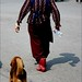 woman and a dog walking
