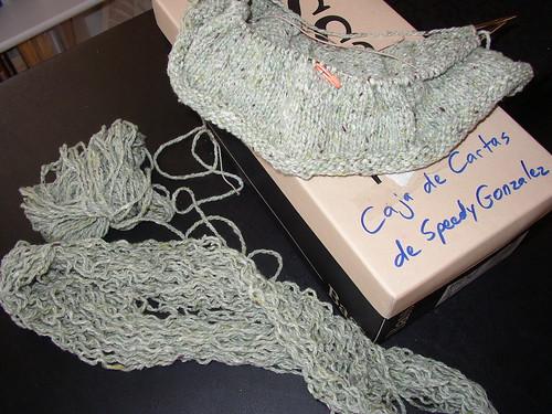 green sweater and yarn pasta