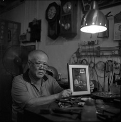 traditional goldsmith at work [click for more photos] (lcy) Tags: bw 6x6 tlr monochrome mediumformat ishootfilm unesco worldheritagesite squareformat nostalgic oldpeople melaka malacca 120mm peopleatwork oldshop  peopleportrait vanishingtrade epsonv700 dyingtrade ilford400delta mamiyac330f peopleihaveasked sekor65mmf35 traditionaltrade malaysia2010