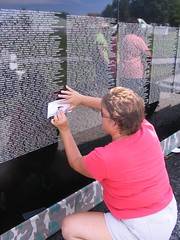 Julie doing a rubbing on the wall
