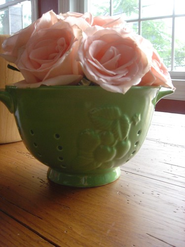 roses in a veggie colander