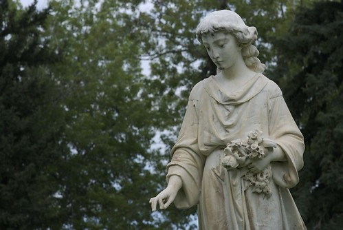 angel photograph from Mt. Olivet Cemetery, Wheat Ridge, Colorado; angel dropping flowers