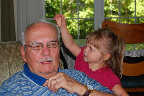 Grace trying to pull poor Grandpa's hair out