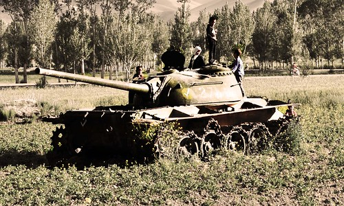 kids playing on soviet tank