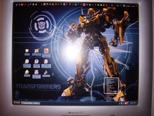 Bumblebee (from Transformers) wallpaper and matching desktop theme.