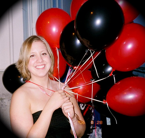 my sister carrying red & black balloons