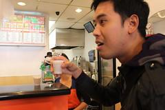 Brian drinking milk tea with a tapioca noodle