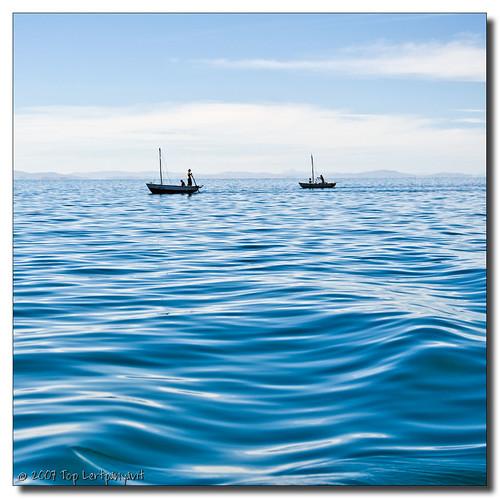 Fishermen on Blue Waves