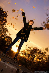 How To Have A Big Harvest, Young girl throwing autumn leaves at sunset time