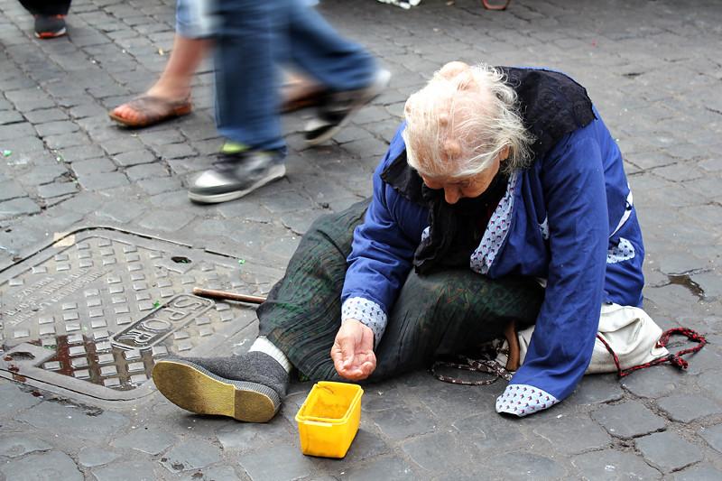 A beggar in Campo de Fiori