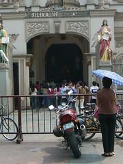 Lady Praying at the Entrance of Basilika Ng Nazareno