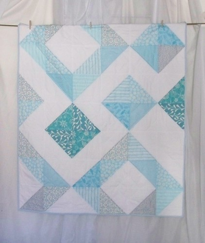 Aqua and white handmade modern half square triangle lapquilt