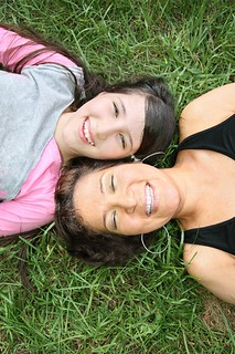smiley mom and daughter on grass