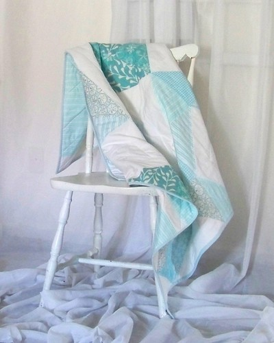 turquoise and white half square triangle quilt