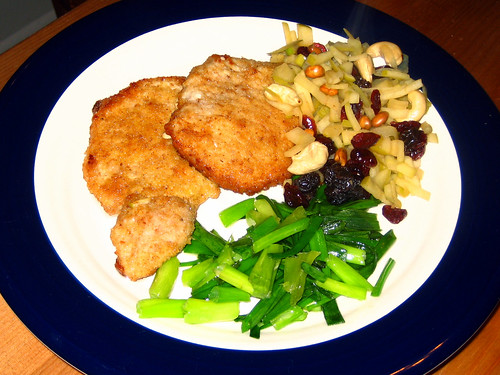 pork chops with fruit and nut topping and green onions
