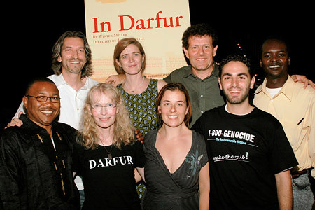 With Mia Farrow, Nick Kristof, Samantha Power and a bunch of non-famous people.  Note the feathering of his hair in this one.  Heaven!  It's as if a gentle breeze is playfully tousling his silken locks as he giggles coquettishly.  (Flickr)
