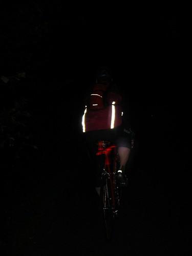 John cycles through thedark