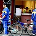 high school students in blue with their bikes