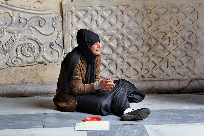 A beggar sitting in the church porch - S. Maria in Trastevere