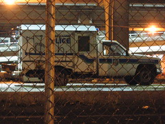 fenced and graffitoed police van