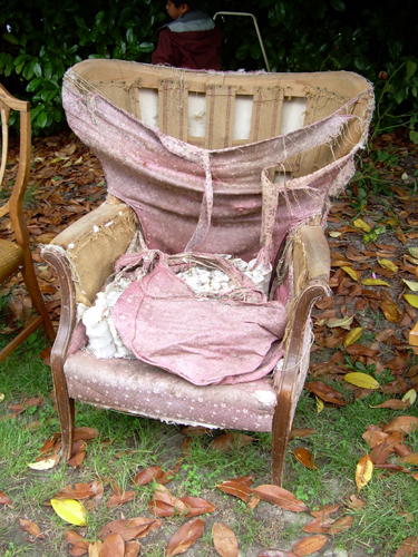 "Ratty-ass chair at the ""free stuff"" yard sale"