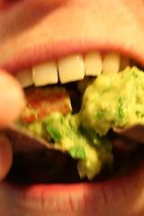 Tito eating guac
