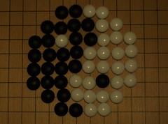 Yin/yang symbol on a go board