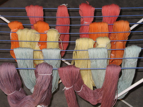 various colors of yarn drying on rack