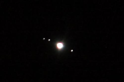 Jupiter and three of its moons