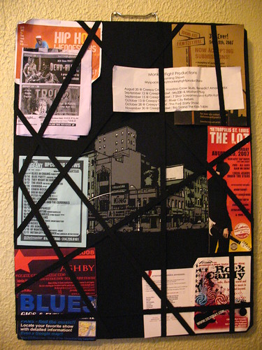 bulletin board with flyers on it