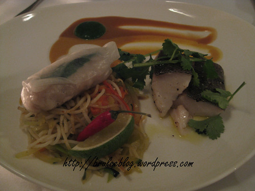 Poached fish with seafood rice roll