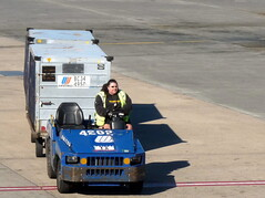 Woman at work--airline baggage handler
