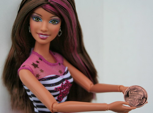 Barbie shows off the new 2010 Lincoln one cent coin