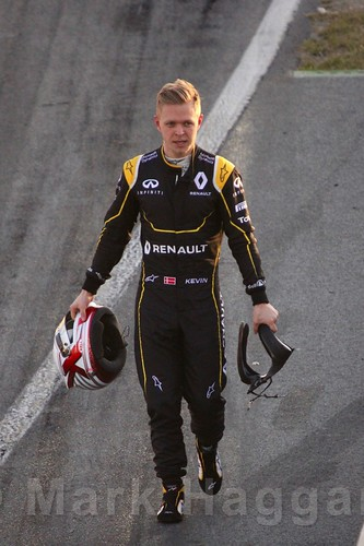 Kevin Magnussen walks back to the pits after his Renault stops during Formula One Winter Testing 2016