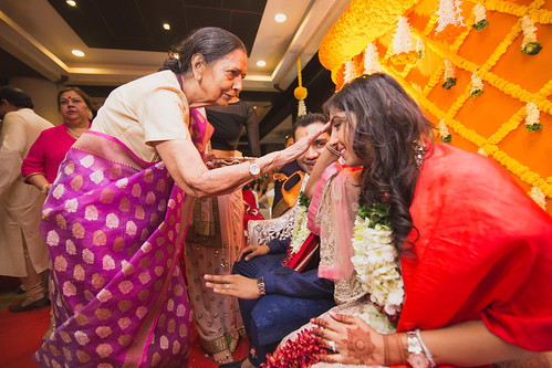 Shivani accepting the blessing of one of the family members at the engagement rituals.