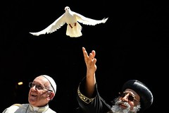 Pope Francis (L) watches as Egypt's Coptic Orthodox Pope Tawadros II releases a dove after a meeting with other religious leaders at the Pontifical Basilica of St Nicholas in Bari, in the Apulia region in southern Italy, on July 7, 2018. (Getty)