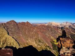 Me on the summit of Pyramid Peak looking towards the Maroon Bells