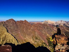 Me on the summit of Pyramid Peak looking towards the Maroon Bells